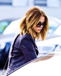 Ashley Benson edgy look.leather jacket, wavy hair gorgeous round sunglasses