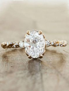 To see more gorgeous engagement rings: http://www.modwedding.com/2014/11/08/loving-untraditional-engagement-rings-like-stunners/ #wedding #weddings #engagement_rings via Ken & Dana Design // I love the stone and setting but not sure about the band