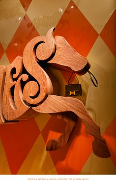House Industries for Maison Hermés in Japan.  Sired from custom cut solid Wisconsin cedar and equitationally interlocking House Industries letterforms, our hand-drawn Hermès horse gracefully canters through a harlequin carousel of letter-borne livery with exceptional alphabetic dressage.