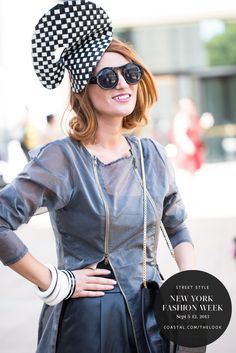 Carmen Negoita is spotted here wearing a standout fascinator, bold round sunglasses and a unique translucent zip jacket. http://instagram.com/carmennegoita | New York Fashion Week | Street Style from Coastal.com | Click to see more on our e-magazine, theLOOK