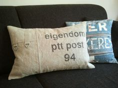 Kussen gemaakt van originele PTT postzak. Moet je wel even zoeken op Marktplaats denk ik... maar wel een leuk idee!