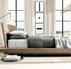 RH Modern's White Hall Platform Bed:Emblematic of 1970s postmodernism, our White Hall collection by designers Thomas Bina and Ed Robinson is crafted of smoked oak, a refined finish that highlights the wood burl and the unique character of each piece.SHOP THE ENTIRE COLLECTION ▸