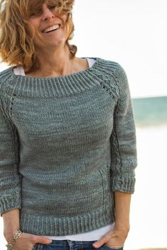 Knit in a gorgeous blue-gray, like the sky and water on the beach in spring. A classic pullover with delicate slip stitch cabling details, which are supposed to look like little waves at the edge of the sand. Twisted rib compliments the yarn and the stitch detail - which continues down the arms, a little hidden, but not quite. The body skimming shape is flattering, with ¾ sleeves and a wide neckline that gives it a vintage vibe and shows a hint of the tank you wear beneath, just in case the…
