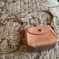 Dusty rose pink and silver Brighton purse The bag shows on the heart on the front of the bag as well as a marking. See photos for details. Could be a long strap shoulder bag or cross body bag. Brighton Bags Crossbody Bags