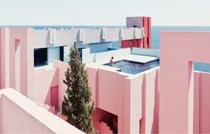 La Muralla Roja is an apartment complex rising from the clifftops of Calpe, a coastal town in Spain. Designed by Ricardo Bofill in 1968.