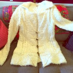Teddy Bear sweater Free People size M NWOT Beautiful Ivory FP sweater/coat. Fully lined with super soft t shirt material. Has pockets on the sides (I tried to show one on the 4th picture) slight bell sleeves, toggle closure on the front and absolutely stunning! Free People Sweaters Cardigans