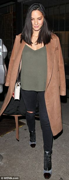 Stunning: Olivia Munn looks so stylish in her camel coat, ripped black jeans and a green camisole top