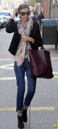 Miranda Kerr looking casual yet chic.  She has it nailed.  Cool oversized scarf, amazing statement purse in a fun color, and classic jeans and a blazer.  Pure dynamite.