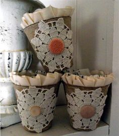Peat pots trimmed with doily bits and vintage findings.  From Speckled Egg's Blog.