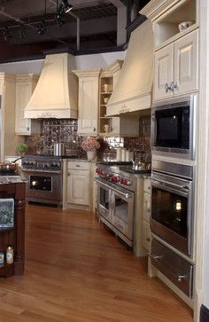 My kitchen shiloh cabinets with inset doors in soft white coffee brown granite countertops for Kitchen design showrooms boston