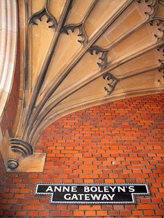Anne Boleyn's Gateway at Hampton Court Palace: ceiling vault and sign.
