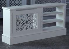 Jali bespoke radiator cover - something like this to cover radiator and accommodate TV - need to figure out how to aim heat aways from tv and electronics. Wall Heater Cover, Made To Measure Furniture, Radiator Cover, Decoration Design, Radiators, Interior Design Living Room, Home Projects, Home Furniture, Sweet Home
