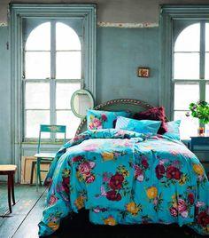 Put a white comforter on the bed and I would love the whole room :) wide plank floors, tall windows, detail framing of the windows, worn vintage turquoise paint <3