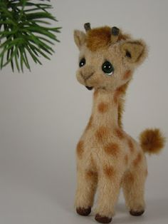 Aww... Needle Felted Giraffe. This reminds me of Precious Moments' style of art because of the eyes on this giraffe.