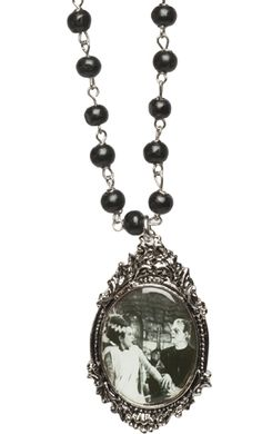 WE BELONG DEAD ROSARY NECKLACE    Even in death these two are together. This rosary necklace from Universal features black beds and a silver, ornate cameo with frankenstein and his bride!     $24.00