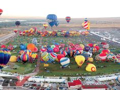 2016 ABQ Balloon Fiesta. Pictures are deceiving. The field is ass large as 57 football fields. Balloons being inflated and made ready for take-off.