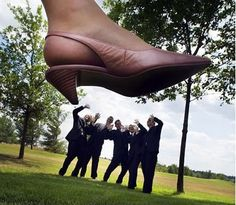 wedding picture ideas funny bride stepping on groomsmen picture wedding photo ideas .... ugly shoes though :P