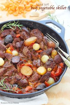 A simple yet satisfying dinner, this one pot beef vegetable skillet has incredible flavors from the carrots, celery, potatoes slow baked in a red wine and tomato sauce