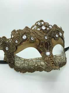 Gold antiqued Mardi Gras Mask with ribbon ties.