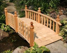 This quality picket rail Japanese garden wooden bridge features reliable construction and will add a unique look to your Japanese style garden or koi pond.
