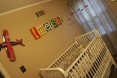 Airplane with banner name! Cute idea! Who says this has to be a baby nursery idea though? This can be for big boys too!