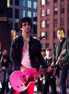 Love how the light makes his guitar pink :)