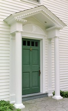Front door entry - pediment with dentil moulding, sunburst, columns. No transom or sidelites.