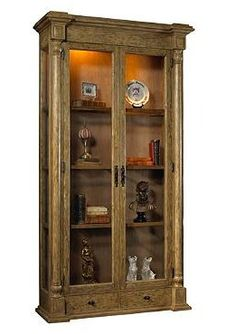 The weathered fir construction of the Vignoble Vitrine Cabinet offers a stylish and statuesque piece for your study or living room that handsomely displays your cherished decor accessories.
