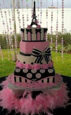 Love this Pink, Black and White Parisian Inspired Tiered Cake! Bows, bling, stripes, dots and a stand as chic as the cake!