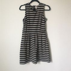 J. Crew knit striped dress Black and cream striped skater dress. Worn a few times. No damages, rips, or stains! J. Crew Dresses