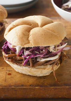 BBQ Beef Brisket Sandwiches with Coleslaw -- Two hands (and napkins) required to enjoy this recipe. That's what it takes to get a hold of this beefy BBQ brisket and coleslaw-filled sandwich dripping with sauce.