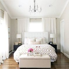 Intrigued by the idea of positioning the bed against the window with curtains across most of the wall