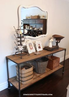 Industrial console table - love it with the vintage mirror eclecticallyvintage.com  Another way to display my tea cup collection!