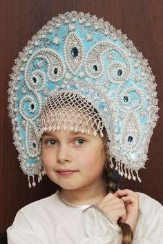 "Russian girl in traditional headdress ""Kokoshnik""."