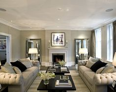 Warm, neutral greige shades with formal furniture layout using symmetry. Lovely