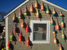 Always love seeing happily painted lobster buoys like these!