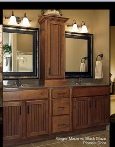 Bathroom remodel with tower & square mirrors. Effective use of squares in a rectangular space.