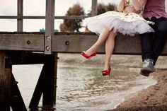 Love the red shoes under a short wedding dress!