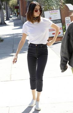 Selena Gomez in a white t-shirt, black cropped J Brand jeans and white sneakers - click through for more celebrities in jeans