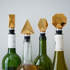 Wine savers. In four graphic shapes, the Geo Stopper Set has silicone bottoms that fit snuggly into bottles, creating an airtight seal that helps preserve wine after it's opened.