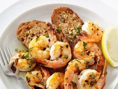 Sautée shrimp with parsley and chives, then serve it atop crunchy garlic toasts.