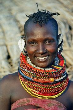 Massai, usually this process of rings around the neck actually alter the body, stretching muscles (of the shoulder and neck) creating the illusion of a longer neck.