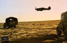 A convoy of lorries belonging to the 2nd New Zealand Division - part of the British Eighth Army in North Africa - is escorted by an RAF Hurricane, pictured here performing a low-altitude flypast. Egypt, 3rd August, 1942.