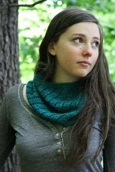 """Use one skein """"Mad Hatter"""" to make a single or double-wrap cowl with spiraling ridges and eyelets. This magical lace pattern is complicated when worked flat, but when worked in the round you only need to remember one simple row."""