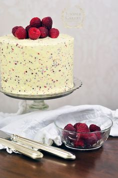 Recipe for a fruity yet peppery Raspberry, White Chocolate and Pink Peppercorn cake by Juniper Cakery