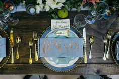 Gold calligraphy with gold beaded charger. Calligraphy by Ali Lavin and design by Kaleb Norman James Design.