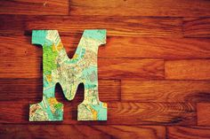 decoupaged map letter--or us a cutout monogram picture frame...?