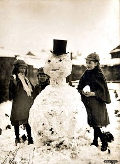 Old snowman.... what a great one with a real top hat!
