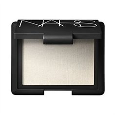 Nars Albatross highlighter. I love this highlighter for my cheekbones. Surprisingly natural on most skin tones--it makes the light hit your face like you are lit up from the inside out!