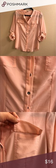 Calvin Klein pale pink button down blouse. NWOT. 3/4 sleeves. Buttons on side. Button down. NWOT. Size small. Never worn. Calvin Klein Tops Button Down Shirts